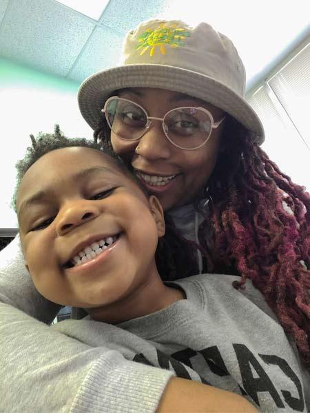 Image of Yacara Mungo Dozier and a kid