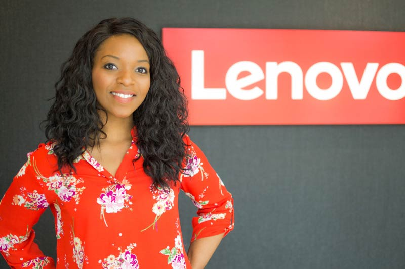 Krystee Chase standing in front of a Lenovo sign