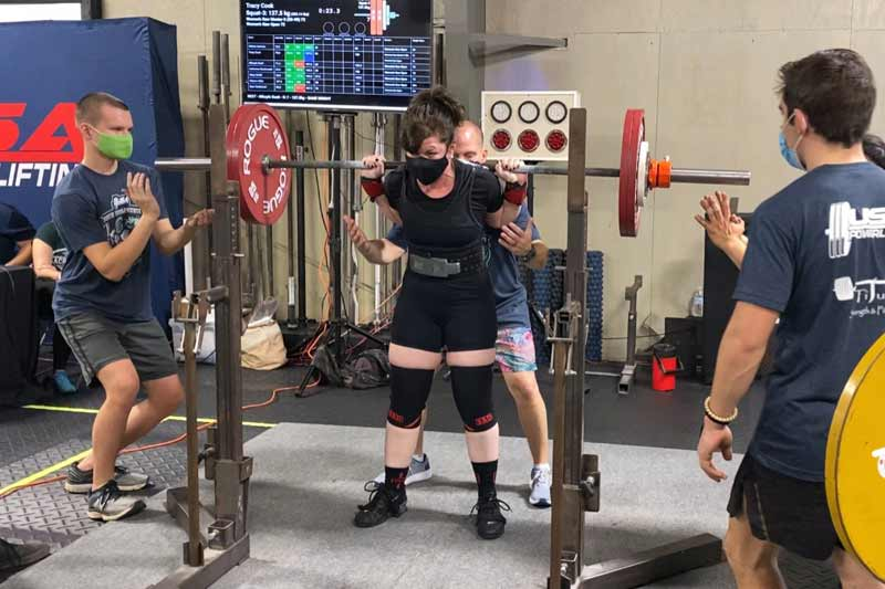 Tracy Cook weightlifting at a gym