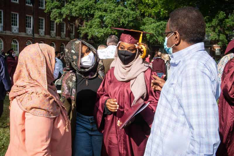 Student with family after graduation