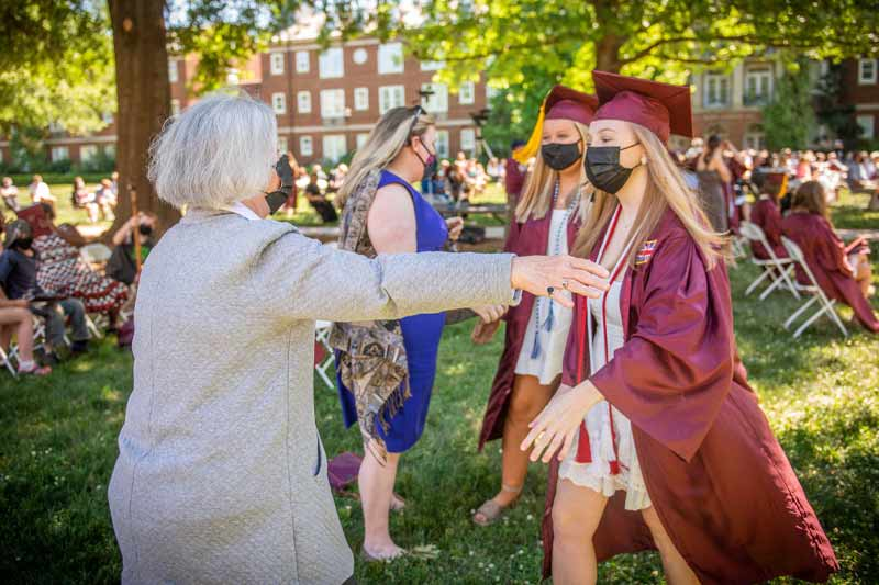 Students celebrating with their families after graduation
