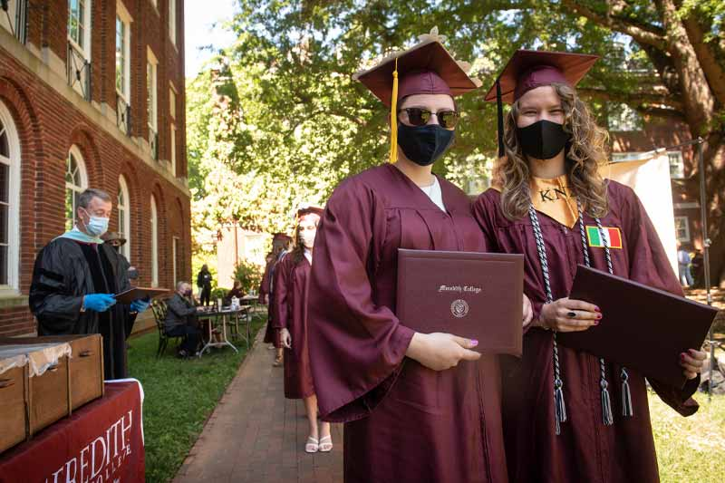 students with their diplomas