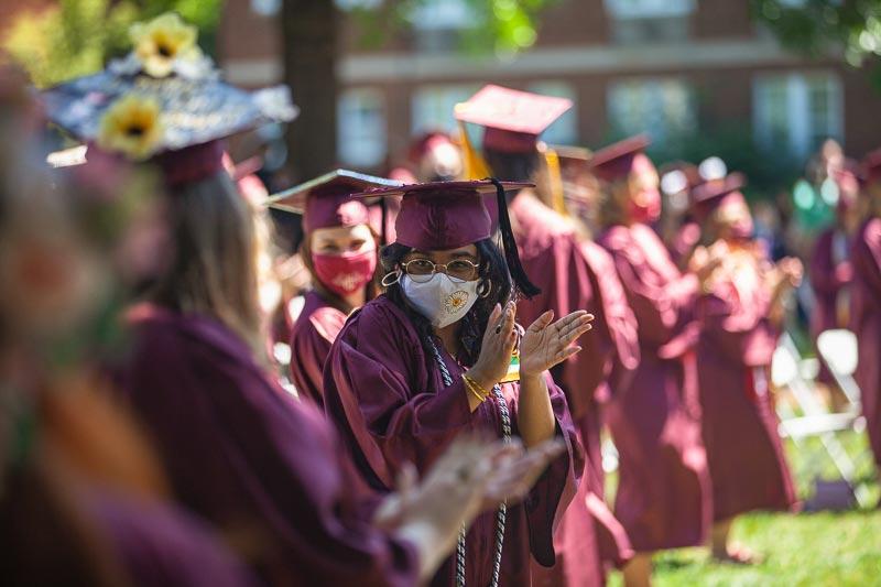 Student smiling behind mask