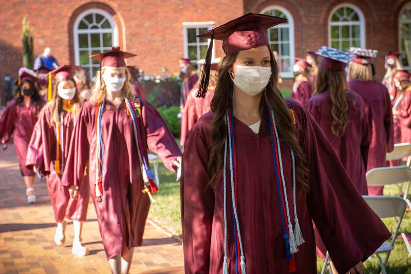 Students walking to receive diplomas