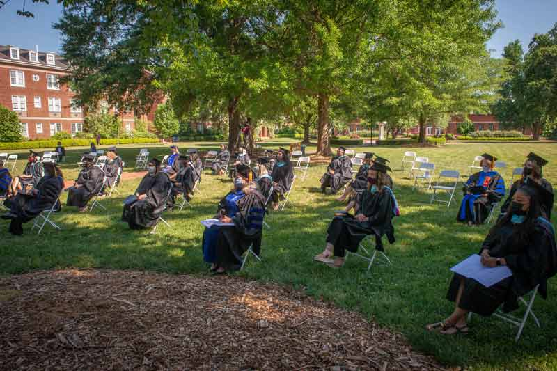 new graduates sitting before their hooding ceremony