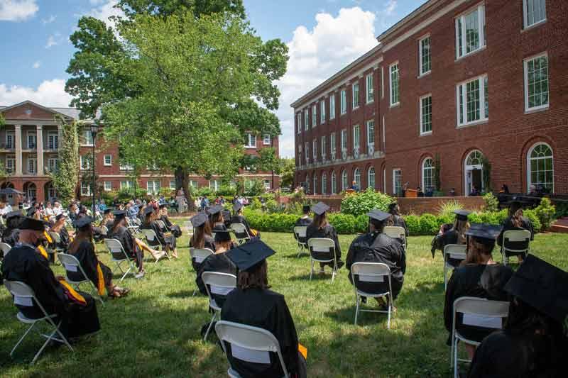 graduates sitting at hooding ceremonies