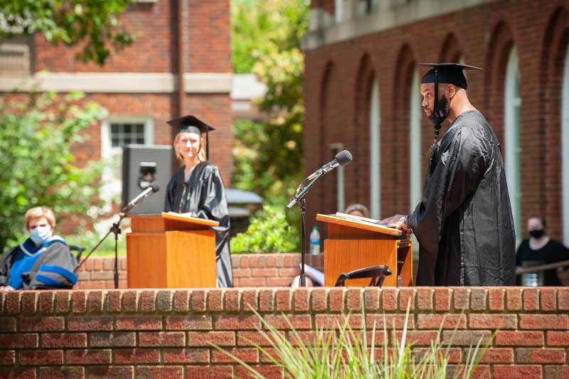 New graduates receiving their diploma