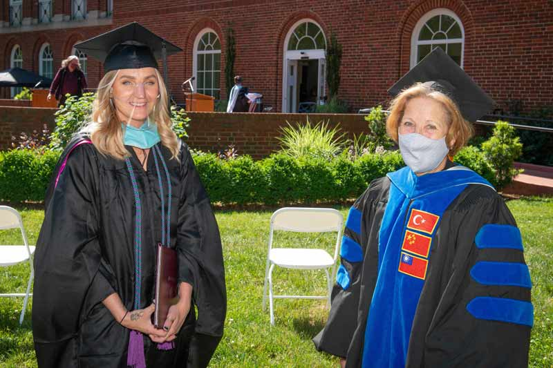 two professors at hooding ceremony